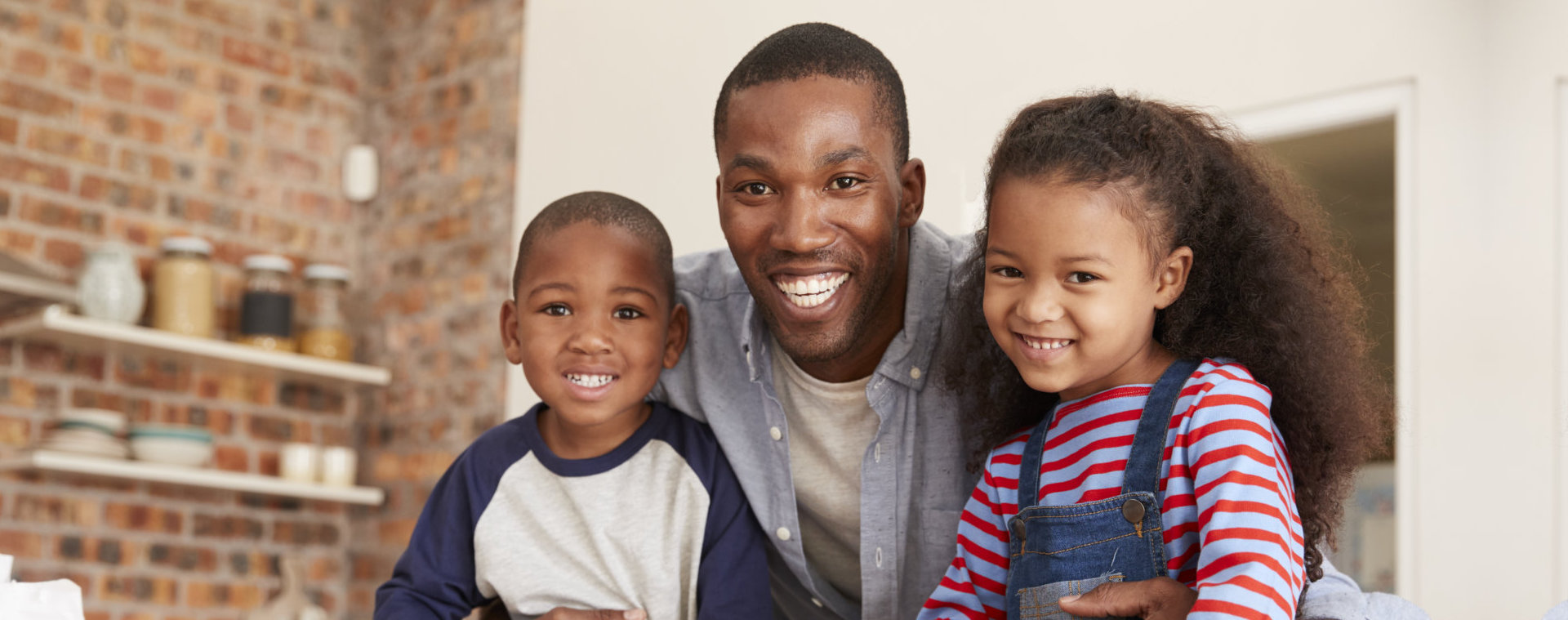 father together with kids smiling